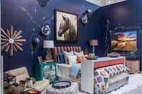 Pickard Design Studio Sarah Pickard used a moody navy in her bedroom vignette. Handpainted gold flourishes and rosettes that add luxury to a space layered with turquoise, orange, blues and browns.( Lance Selgo  -  Unique Exposure Photography )