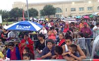 Hundreds of school kids and their parents waited in the rain Friday morning at Fair Park for the annual Dallas Mayor's Back-to-School Fair.David Woo - Staff Photographer