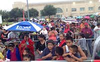 Hundreds of school kids and their parents waited in the rain Friday morning at Fair Park for the annual Dallas Mayor's Back-to-School Fair.(David Woo - Staff Photographer)