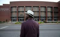 James Wright waits for the Friendly Temple Missionary Baptist Church to open for the funeral service of Michael Brown Monday in St. Louis. Several days of violent protests, along with rioting and looting, erupted after Brown was shot and killed by a police officer on Aug. 9 in the nearby town of Ferguson, Mo.(Joe Raedle - Getty Images)