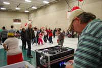 Little Elm resident Shane Manning deejays for the dance party in the gymnasium at Memorial Park Recreation Center in Lewisville. Manning volunteers his services every month.(Staff photo by DANIEL HOUSTON)