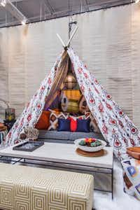 Pickard Design Studio Sarah Pickard partnered with Robert Allen Design, a textiles showroom. Pickard's use of fabrics included a tent big enough for a sofa and several friends to gather for a gabfest.Lance Selgo  -  Unique Exposure Photography