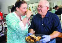 Mack Yarbrough shares some chicken he cooked on the Egg with Melissa Amick. Yarbrough teaches grilling classes at Barbeques Galore on Lovers Lane and gives lessons privately.