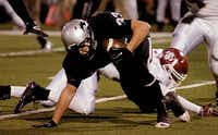 Denton Guyer running back Nate Maki (33) plants his arm to regain his balance after being hit behind the line of scrimmage in a November 2012 game against Saginaw. Maki camping with friends Saturday night ahead of Sunday's opening of dove season when he suffered a fatal gunshot wound, Montague County Sheriff Paul Cunningham said.File 2012 - Denton Record Chronicle