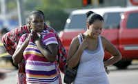 Parents LaKesia Brent (left) and Eunice Pacheco wait for news about their children Wednesday morning outside Spring High School after several people were stabbed in an incident at the school. The Harris County Sheriff's Office said one person was killed and several injured, including a 16-year-old boy who was airlifted to a hospital.(David J. Phillip - The Associated Press)