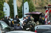 Security personnel respond Monday near the Washington Navy Yard, where at least one gunman opened fire inside a building, killing six people were killed and wounding at least four more, including a law enforcement officer.(Manuel Balce Ceneta - The Associated Press)