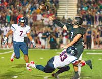 Allen defensive lineman Marcus Davis (93) tackles Hebron quarterback Carson Profitt (7) as he throws during the Sept. 20 game at Hebron. Profitt completed 15 of 28 passes for 168 yards in the 36-17 loss.
