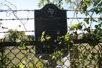 <TypographyTag11>A state historical marker</TypographyTag11> at McCree Cemetery describes that the site dates back to 1866, when Mahulda McCree deeded the first land for the cemetery.Staff photo by HEATHER NOEL