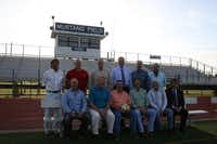 J.J. Pearce High School alumni, who graduated in the mid- to late-1970s, gathered on the school's soccer field on May 1. The group includes (back row) Luis Sifuentes, Wade Saulsberry, Bradley Anderson, Toby Grove, David Musgrove, Tom Gray, (front row) Kelley Meeker, Tommy Jones, Brad Scott, Mike Anderson, Craig Rind and Mike Tannery. After their friend and fellow teammate, Rob Harper, died in January, members of the group began efforts to establish an award and memorial fund in his honor.(Staff photo by HEATHER NOEL - neighborsgo)
