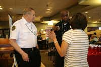 Lopez (right front) talks with Neighborhood police officer Bervin Smith at the breakfast.HEATHER NOEL - neighborsgo staff