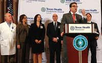 Texas Gov. Rick Perry speaks at the start of a news conference Wednesday at Texas Health Presbyterian Hospital of Dallas to discuss developments in the Dallas Ebola case.(Vernon Bryant - Staff Photographer)