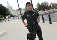A U.S. Capitol police officer armed with an assault rifle responds after shots were fired at or near the Capitol Thursday in Washington. The entire Capitol complex was locked down for about an hour, and a police officer was reported injured.Win McNamee - Getty Images