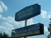 "Hurricane Harbor's sign greets guests as they enter the park. The sign claims the park to be ""bigger, better, and wetter.""HASH(0x8bf30bc)"