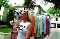 May 2002 - As Salvation Army fashion show chairman, Heidi Dillon rolls a rack of donated clothing down her driveway to the truck delivering it to the event.(Courtney  Perry)