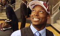 Thomas Johnson smiles after formally committing to Texas A&M at Dallas ISD's National Signing Day ceremony on Feb. 1, 2012. Johnson, who abruptly left the A&M program after its stunning win over Alabama later that year and never played college football again, was arrested in Monday's brutal slaying of a jogger on White Rock Creek Trail in Dallas.File 2012 - Staff Photo