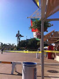 Barriers and fire line tape restrict access to the area around Big Tex after a fire burned away most of the big cowboy's exterior on Friday.(Nathan Hunsinger)