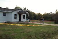 Fire line and crime scene tape surrounds the home of Charles Everett Brownlow Jr. Tuesday morning in Terrell. Brownlow, suspected in a string of five slayings that unfolded at four locations in Terrell, was captured about 1:30 a.m. Tuesday after an intense manhunt tracked him to a creek in a wooded area near U.S. Highway 80.(Christina Rosales - Staff)