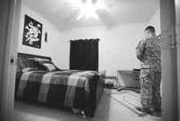 In the guest room of his apartment in Killeen, Sgt. Fahad Kamal, a medic who served in Afghanistan, uses a prayer rug given to him by his mother.