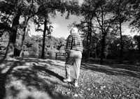 Lee Sneller, who is in the early stages of Alzheimer's disease, takes a daily walk in his Flower Mound neighborhood - one of the few activities he does on his own. 'Isn't this peaceful?' he says at his favorite shady spot near the pond.