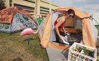Lizzy Wetzel of Dallas packs books from her tent Tuesday at the Occupy Dallas encampment outside Dallas City Hall. A judge denied the group's request for a temporary restraining order to block the city from shutting down the camp.