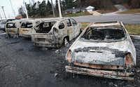 Burned-out cars Tuesday morning in Dellword, Mo., give evidence of the rioting that occurred Monday night after a grand jury declined to indict Ferguson, Mo., police officer Darren Wilson in the Aug. 9 shooting death of 18-year-old Michael Brown.(Scott Olson - Getty Images)