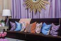 Mecox The Knox-Henderson retailer's vignette features a chocolate sofa layered with pillows in a pastel colorway. Piles of pillows are a way to inject personality in a setting. Note the gold starburst mirror.Lance Selgo  -  Unique Exposure Photography