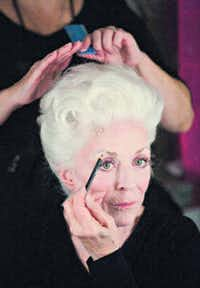 With the help of Lynne Fredrichsen, Holland Taylor undergoes her transformation to the part of former Texas Gov. Ann Richards before a dress rehearsal.