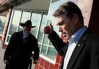Rick Perry gave a supporter a thumbs-up outside a coffee shop in Creston, Iowa, on Tuesday.