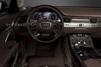 The 2014 Audi A8L TDI's audio/navigation screen rises from the center of the dash when the car is started.