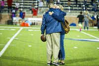 Allen head coach Tom Westerberg gets a hug from his wife Sandra after a win over Hebron in a high school football game at Eagle Stadium on Friday, Oct. 9, 2015, in Allen. Allen won the game 45-13 for the Eagles 50th consecutive victory. (Smiley N. Pool/The Dallas Morning News)(The Dallas Morning News)