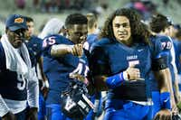 Allen running back Kirby Bennett (45) and linebacker Sione Tupou (5) ham it up on the sidelines during the fourth quarter of a high school football game against Hebron at Eagle Stadium on Friday, Oct. 9, 2015, in Allen. Allen won the game 45-13 for the Eagles 50th consecutive victory. (Smiley N. Pool/The Dallas Morning News)(The Dallas Morning News)