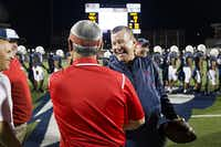 Allen head coach Tom Westerberg clutches a game ball as he celebrates with his assistants during after a win over Hebron in a high school football game at Eagle Stadium on Friday, Oct. 9, 2015, in Allen. Allen won the game 45-13 for the Eagles 50th consecutive victory. (Smiley N. Pool/The Dallas Morning News)(The Dallas Morning News)