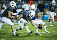 Hebron linebacker Chris Braman (18) recovers a fumble by Allen quarterback Mitchell Jonke during the fourth quarter of a high school football game at Eagle Stadium on Friday, Oct. 9, 2015, in Allen. Allen won the game 45-13 for the Eagles 50th consecutive victory. (Smiley N. Pool/The Dallas Morning News)(The Dallas Morning News)