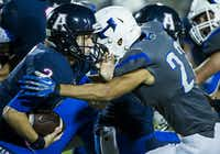 Allen quarterback Mitchell Jonke (2) is brought down by Hebron linebacker Jacob Thimesch (22) during the fourth quarter of a high school football game at Eagle Stadium on Friday, Oct. 9, 2015, in Allen. Allen won the game 45-13 for the Eagles 50th consecutive victory. (Smiley N. Pool/The Dallas Morning News)(The Dallas Morning News)