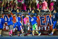Allen players Jakob Yandell (13), Sione Tupou (5) and Tristan Thompson (70) celebrate with fans after a win over Hebron in a high school football game at Eagle Stadium on Friday, Oct. 9, 2015, in Allen. Allen won the game 45-13 for the Eagles 50th consecutive victory. (Smiley N. Pool/The Dallas Morning News)(The Dallas Morning News)