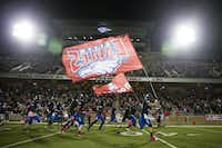 Allen players take the field to face Hebron in a high school football game at Eagle Stadium on Friday, Oct. 9, 2015, in Allen. (Smiley N. Pool/The Dallas Morning News)(The Dallas Morning News)