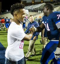 Former Allen, now Texas A&M, quarterback  Kyler Murray shakes hands with offensive lineman  Gregory Little (74) on the sidelines at the end of the the first half of a high school football game against Hebron at Eagle Stadium on Friday, Oct. 9, 2015, in Allen. (Smiley N. Pool/The Dallas Morning News)(The Dallas Morning News)