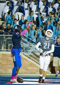Allen wide receiver Lionell McConnell (11) celebrates after catching a 42-yard touchdown pass past as Hebron defensive back Joseph Angelone (21) during the first quarter of a high school football game at Eagle Stadium on Friday, Oct. 9, 2015, in Allen. (Smiley N. Pool/The Dallas Morning News)(The Dallas Morning News)