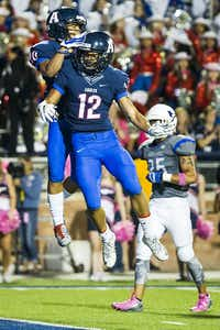 Allen wide receiver Jared Tajalle (10) celebrates with Carson Schleker (12) after catching a 24-yard touchdown pass during the first quarter of a high school football game against Hebron at Eagle Stadium on Friday, Oct. 9, 2015, in Allen. (Smiley N. Pool/The Dallas Morning News)(The Dallas Morning News)