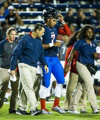 Allen quarterback Seth Green (7) leaves the game after being shaken up on a play during the second quarter of a high school football game against Hebron at Eagle Stadium on Friday, Oct. 9, 2015, in Allen. (Smiley N. Pool/The Dallas Morning News)(The Dallas Morning News)