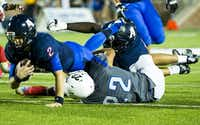 Allen quarterback Mitchell Jonke (2) is brought down by Hebron linebacker Jacob Thimesch (22) during the second quarter of a high school football game at Eagle Stadium on Friday, Oct. 9, 2015, in Allen. (Smiley N. Pool/The Dallas Morning News)(The Dallas Morning News)