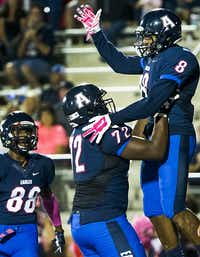 Allen wide receiver Tenio Ayeni (8) celebrates with offensive lineman William Sherman (72) after catching a 17-yard touchdown pass during the second quarter of a high school football game against Hebron at Eagle Stadium on Friday, Oct. 9, 2015, in Allen. (Smiley N. Pool/The Dallas Morning News)(The Dallas Morning News)