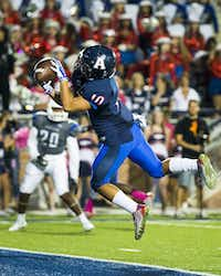 Allen wide receiver Jared Tajalle (10) catches a 24-yard touchdown pass during the first quarter of a high school football game against Hebron at Eagle Stadium on Friday, Oct. 9, 2015, in Allen. (Smiley N. Pool/The Dallas Morning News)(The Dallas Morning News)