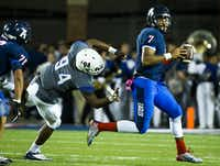 Allen quarterback Seth Green (7) scrambles away from Hebron defensive lineman Nathan Grant (94) during the second quarter of a high school football game at Eagle Stadium on Friday, Oct. 9, 2015, in Allen. (Smiley N. Pool/The Dallas Morning News)(The Dallas Morning News)