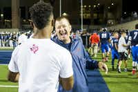 Allen head coach Tom Westerberg hugs former Allen, now Texas A&M, quarterback  Kyler Murray on the sidelines during the first half of a high school football game against Hebron at Eagle Stadium on Friday, Oct. 9, 2015, in Allen. (Smiley N. Pool/The Dallas Morning News)(The Dallas Morning News)