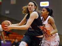 Flower Mound center Lauren Cox (44) drives the lane past El Paso El Dorado guard Ebonie Ballesteros (12) in the second half of the Class 6A Region I semifinal at Wilkerson-Greines Athletic Center in Fort Worth, Saturday, February 28, 2015. (Tom Fox/The Dallas Morning News)(Tom Fox/Staff Photographer)