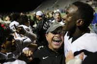 Plano East head coach Joey McCullough celebrates with wide receiver Audie Omotosho (right) and other players after a high school football game between Plano East and Hebron at Hawk Stadium in Carrollton, Texas Thursday October 29, 2015. Plano East beat Hebron 21-14. (Andy Jacobsohn/The Dallas Morning News)(The Dallas Morning News)