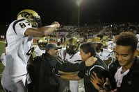 Plano East head coach Joey McCullough (bottom left) celebrates with his team after a high school football game between Plano East and Hebron at Hawk Stadium in Carrollton, Texas Thursday October 29, 2015. Plano East beat Hebron 21-14. (Andy Jacobsohn/The Dallas Morning News)(The Dallas Morning News)