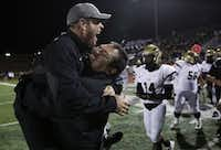 Plano East head coach Joey McCullough is lifted by offensive line coach Jacob Ramon in celebration after a high school football game between Plano East and Hebron at Hawk Stadium in Carrollton, Texas Thursday October 29, 2015. Plano East beat Hebron 21-14. (Andy Jacobsohn/The Dallas Morning News)(The Dallas Morning News)