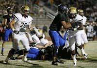 Plano East running back Desmond Bowden (28) gets by Hebron inside linebacker Kameron Isom (2) to score a rushing touchdown to make the score 6-0 in the first quarter during a high school football game between Plano East and Hebron at Hawk Stadium in Carrollton, Texas Thursday October 29, 2015. (Andy Jacobsohn/The Dallas Morning News)(The Dallas Morning News)